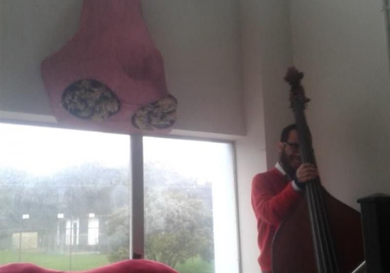 Isaac Smith taking pause, holding his double bass